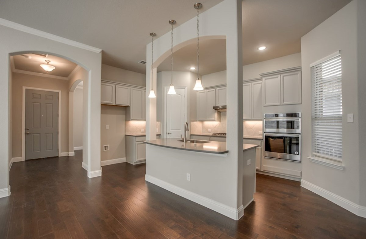 Eastland quick move-in open kitchen with island and white cabinets