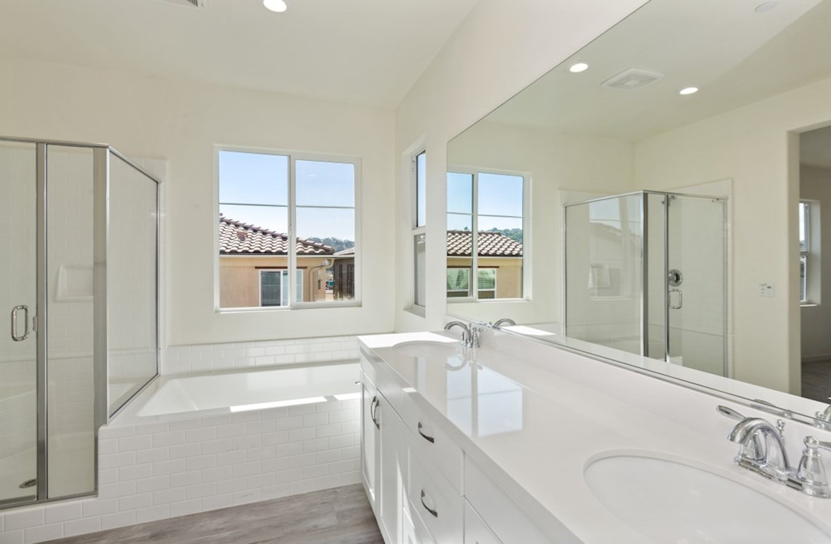 Suncup quick move-in Spa-inspired luxury abounds in the deluxe master bath, complete with separate shower and soaking tub